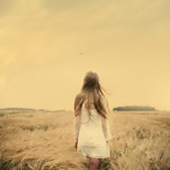 beautiful girl walks into the field