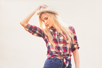 hipster beautiful blonde in a country style