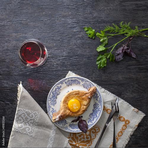 Khachapuri on plate with herbs - 81833266
