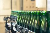 Fototapeta Many bottles on conveyor belt