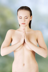 Beautiful spa woman with hands clapped.
