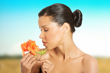 Exotic woman with orange flower.