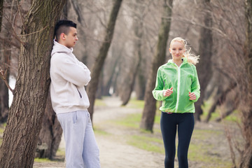 Young female athlete practicing in nature with her coach