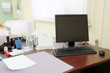 Doctor office table with office tools, monitor, mouse