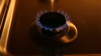 A small gas burner with blue flames filmed at 2x speed