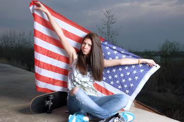 Casual trendy girl american flag and skateboard  crossed legs