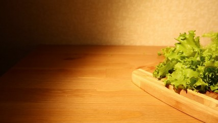 A view of fresh lettuce on a cutting board on a kitchen table