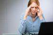 Businesswoman with Migraine or Headache