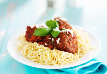 spaghetti and meatballs with parmasan cheese