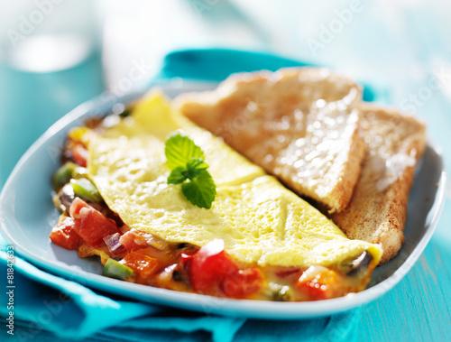 Fotobehang Egg breakfast omelette with buttered toast