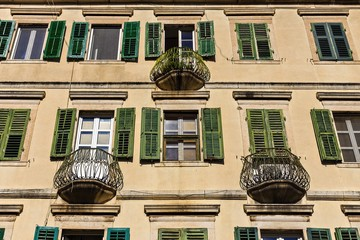 Mediterranean facade of the old building with balconies