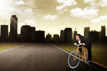 Business Woman Riding Bike Concept
