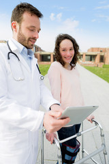 Doctor showing reeducation's tips on tablet