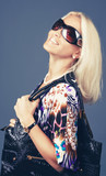 Smiling blond woman in sunglasses