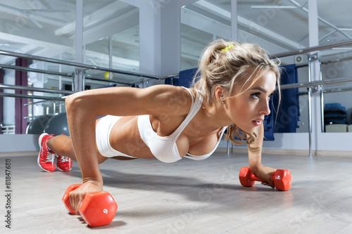Leinwanddruck Bild Woman push-ups on the floor