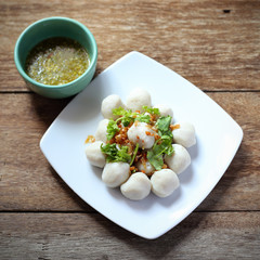 fish meat ball in plate on wood table