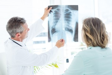 Doctor showing xray to his patient