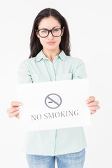 Brunette holding no smoking card