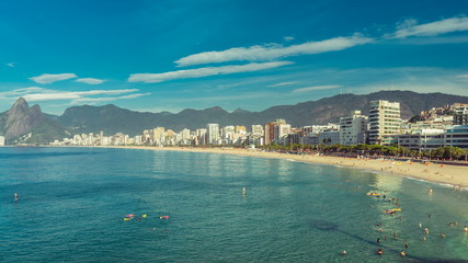 Panning time lapse with people swimming in the ocean, Rio