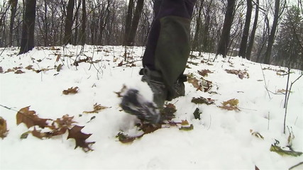 Snow and male feet. POV clip