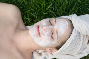 Woman having facial mask in the garden
