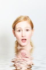 Shocked Woman at the Water Looking at Camera