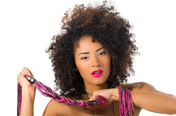 exotic beautiful young girl with dark curly hair holding whip