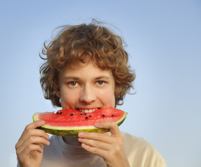 happy teenager eating watermelon