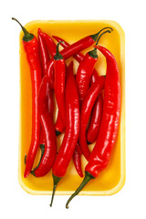 Red chili peppers in the yellow container