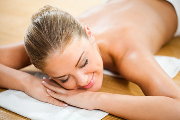 Young woman relaxing after massage on spa treatment