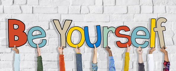 Group of Hands Holding Word Be Yourself Concept