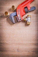 Organized Copysoace Monkey Wrench And Brass Pipe Connectors On W