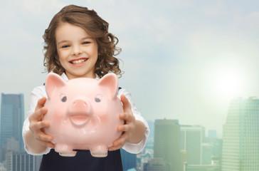 happy girl holding piggy bank