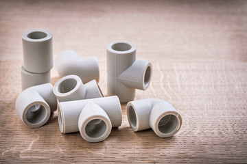 Set Of Polypropylene Pipe Fittings On Wooden Board