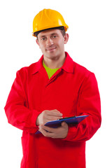 smiling young worker wearing working clothes holding clipboard a