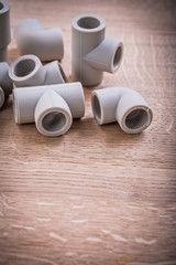 Somposition Of Polypropylene Pipe Fittings On Wooden Board