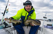 Happy angler with two Baltic cods