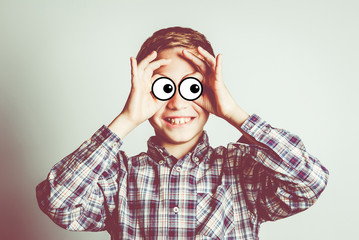 funny little boy with cartoon eyes