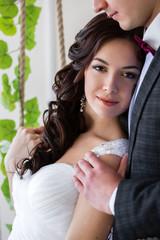 Bride leaning on bridegroom