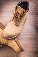 working boots On Wooden Board