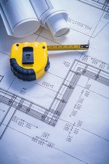 yellow tapeline and blueprints