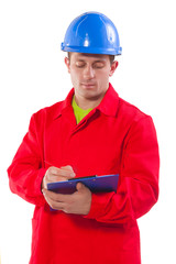 young worker writing in clipboard