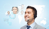 smiling businessman in headset