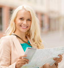 beautiful woman with map in the city