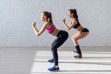Tough stamina training for two young stunning fitness models