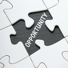 The word Opportunity revealed by a missing jigsaw piece