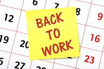 Back To Work reminder note on a wall calendar