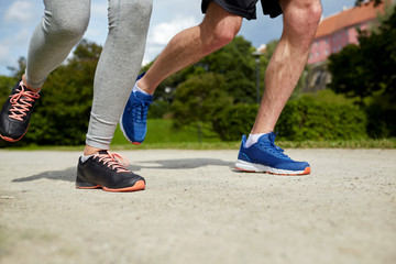 close up of couple running outdoors