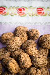 Organic walnuts on vintage kitchen cloth, clean eating concept