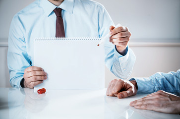 Businessman Holding Empty Notebook with Copy Space